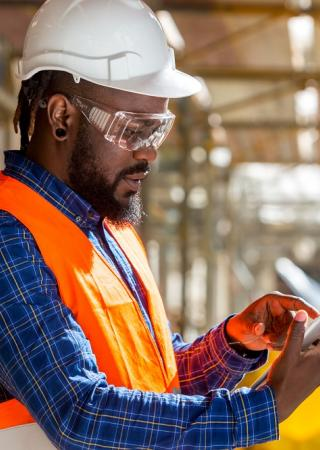 man inspecting a construction site